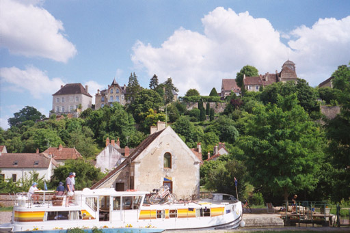 The view from our mooring an Chatel Censoir --  boats passing thru the lock and the hilltop village