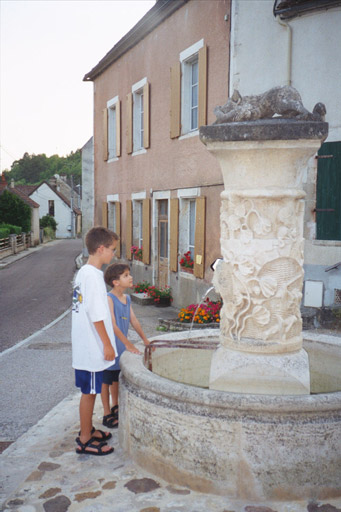 "Patrick and Christopher at the ""magic"" fountain at Mailly le Chateau"